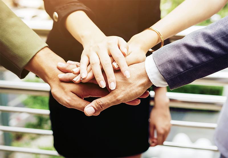 marketing-agency-toronto-final-phase-meeting-teamwork-hands-in